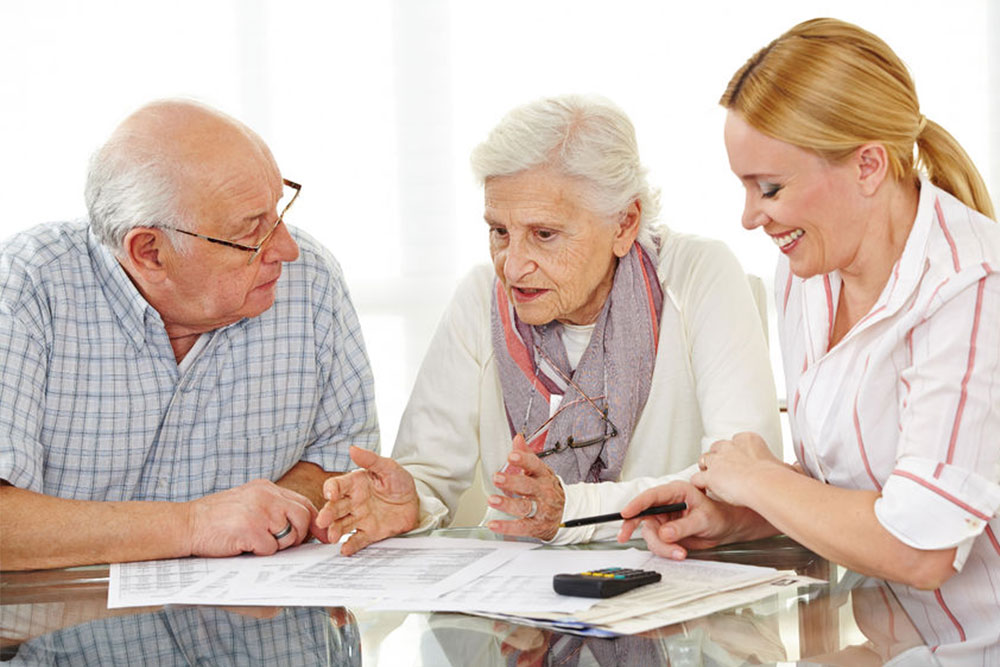 Senior citizens couple argueing over a contract with a social worker