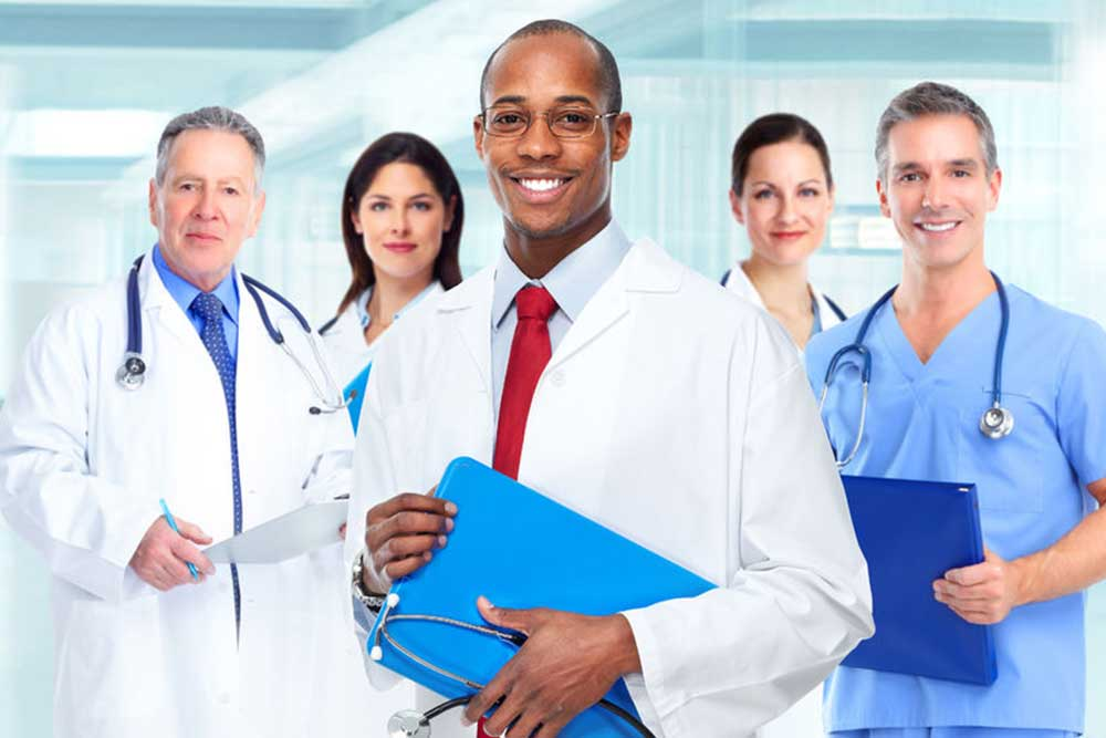 Medical physician doctor man and group of business people.
